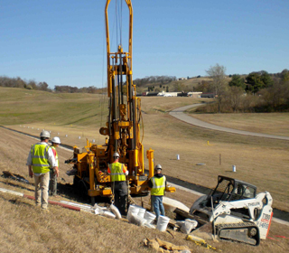 Geotechnology engineers working at field project site