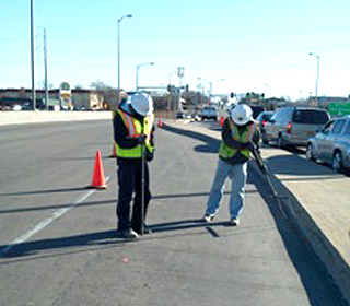 Geotechnology engineers working at roadside project site