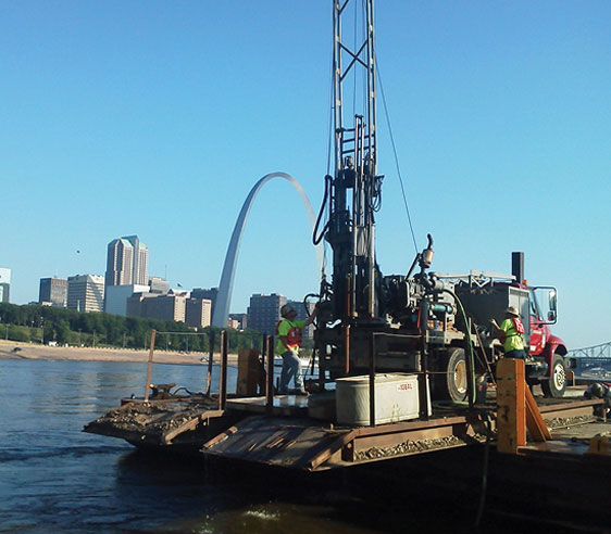Geotechnology engineers working at Mississippi River in St. Louis project site